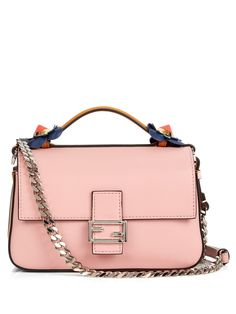 Fendi's Fashion Show Double Micro Baguette bag is a design of two halves. It's innovatively constructed with contrasting flap fronts that mirror each other – one in dark-blue and the other in baby-pink calf leather. Carry it across the body of an off-the-shoulder white dress for an on-point summer look.