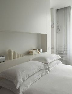 Beyond the Storage Headboard 10 Bedrooms with Recessed Shelving is part of White bedroom Shelves - An abovebed storage solution for the accident prone or those living along fault lines White Interior, Home, Bedroom Inspirations, Home Bedroom, Bedroom Interior, Headboard Storage, White Rooms, Shelves In Bedroom, Beautiful Bedrooms