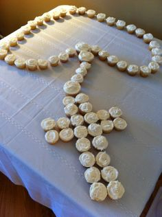Rosery cupcakes ..For a holy communion. Use flower blossoms or SetToCelebrate.com's personalized table sprinkles to decorate the table around the cupcakes to make more festive!