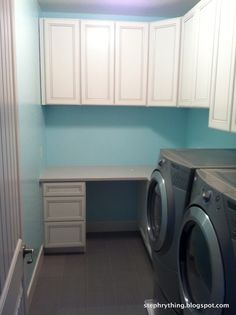 Maximize space for a small laundry craft room. Spa blue paint, white antiqued cabinets, sparkling quartz countertop. From a bit of stephrything