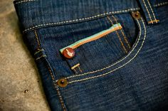 pocket colour detail- woven in to denim fabric