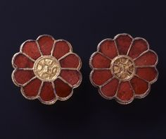 In the 6th Century these were decorated almandine disc brooches .
