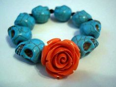 ❤ ❤ ❤ This Dia de los Muertos bracelet.  I almost bought a strand of those turquoise skulls at the last bead show...  I'm definitely getting one at the next show!!!