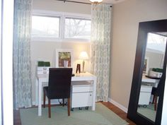 Floor length curtains to elongate short wide windows.