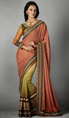 Appear ethnic in this peach puff, cream and mehendi green crepe jacquard half n half saree. This attire is nicely made with lace, resham and stones work.  #StunningEveningSareeCollection