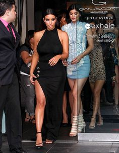 Kim Kardashian turned heads at Khloe's 30th by showing a ton of leg in a Balmain gown with a drastic thigh-high slit.