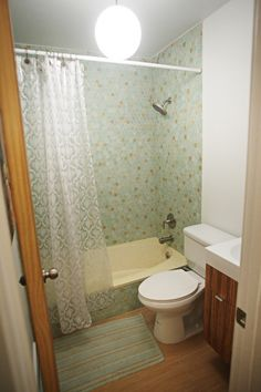 modern bathroom remodel with zebrawood floating vanity and plank ceramic tile floors