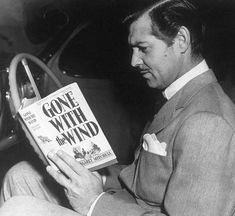 "Clark Gable pictured reading ""Gone With The Wind"" circa 1939"