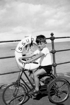 Keith Richards, a b childhood photo, vintage photo, before fame portrait, tricycle