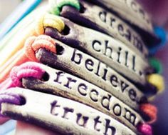 Cord bracelets with metal middl with scripted words