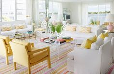 Tons of white and pops of bright colors gives this living room a fresh, preppy Palm Beach vibe.