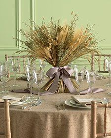 Make a simple yet elegant Thanksgiving centerpiece out of wheat stalks and ribbon
