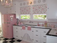 Retro pink kitchen-love the fridge,chandelier,sink and blinds so perfectly pretty. Love the floor too, and the black trim on counter tops.:
