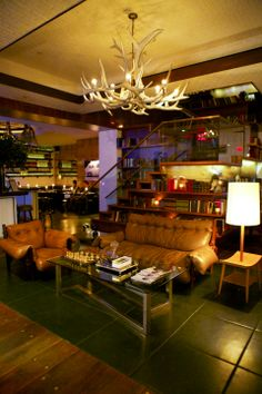Cozy Library Bar downstairs is a good place to hobnob with the in crowd. Gild Hall - Thompson Suite, NY.
