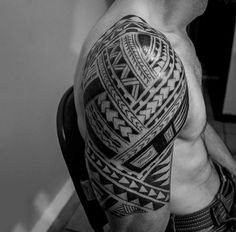 Guy With Upper Arm Tattoo Of Maori Tribal Ink