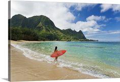 Hawaii, Kauai, Haena Beach, Woman Entering Ocean With Surfboard