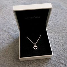 NEW PANDORA HEART NECKLACE Received it as a gift but it is not my style. Never worn, new condition! Beautiful as a gift or for yourself! Chain and Pendant included. PRICE IS FIRM Pandora Jewelry Necklaces