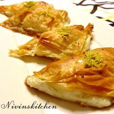 Warbat bil Ashta ( Fillo dough triangles filled with milk pudding )   Nivin's Kitchen