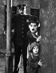 The Kid was an American silent comedy-drama film made in 1921 and directed by Charlie Chaplin. Charlie Chaplin was born on April in Walworth, UK. He died on December in Vevey, Switzerland. Old Hollywood, Classic Hollywood, The Kid 1921, Charlie Chaplin Movies, Charly Chaplin, Charles Spencer Chaplin, Films Cinema, Movies And Series, Kids Poster