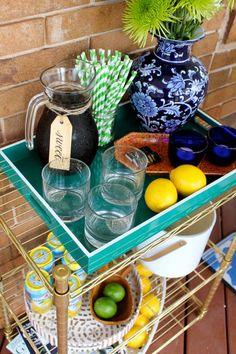 Invite friends and family over for sweet tea on the front porch. Make it easy with a DIY bar cart like this one from Amy Mikkelsen. Diy Bar Cart, Bar Carts, Diy Arts And Crafts, Diy Crafts, Home Depot Coupons, Fresco, Gold Drinks, Style Challenge, Small Patio