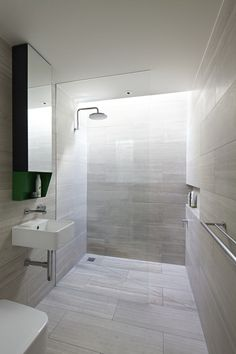 Floor to ceiling stone walls combined with recessed niche for concealing shower supplies.