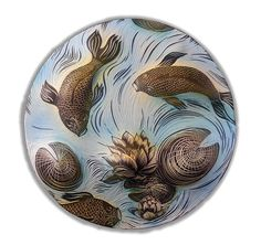 Koi and Lily Pads Disc by Natalie Blake. Like a tranquil garden pond, this hand-carved ceramic sculpture is enchanting to behold. The clay is first press molded to give it shape and depth, then coated with glaze and black slip. To create her design, the artist