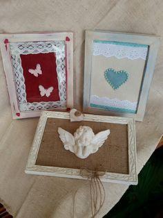 Cornici verniciate e decorate con stoffa, pizzo, minuteria in legno, angelo in polvere di marmo.