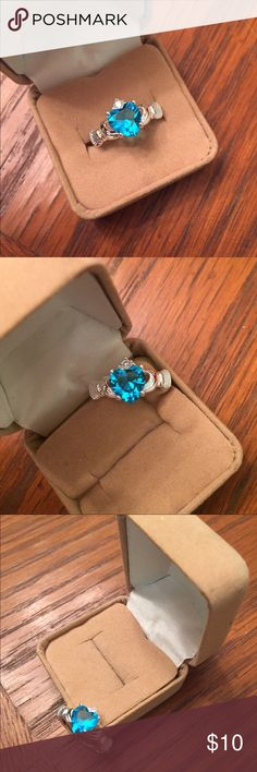 NWT STERLING SILVER HEART RING 7 NWT ladies SS (#925) blue ice heart ring. Beautifully designed with a crown of CZ crystals around heart. Size 7 comes in gift box Jewelry