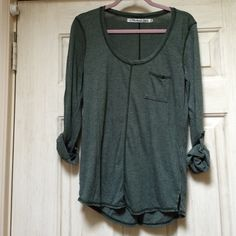 Michael stars olive colored knit tee Worn a few times but no defects. Comfortable and easy to throw on. The sleeves can be rolled down too. Great for holidays, lounging and more! Michael Stars Tops