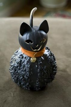 Our black cat Raven comes in two sizes. The small is approximately 5 inches in diameter.