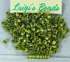 Excited to share the latest addition to my #etsy shop: Toho 6/0 E Japanese Glass Seed Beads #996- Gold-Lined Rainbow Peridot 20g http://etsy.me/2ECX06B #supplies #toho #japanese #ebeads #seedbeads #glass #round #gold #rainbow