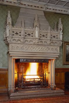 The monumental Gothic fireplace at Tyntesfield designed by Norton for the Staircase Hall, with statues symbolising Fortitude, Temperance, Justice and Prudence.
