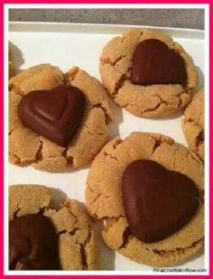 Chocolate Kiss Cookies 1 ¾ cup flour 1 tsp baking soda ½ tsp salt ½ cup shortening ½ cup peanut butter ½ cup white sugar (keep an extra ¼ cup out for rolling) ½ cup brown sugar 1 egg 2 tbsp milk 1 tsp vanilla 24-30 chocolate candies – could use Brach Stars, Hersey Kisses, Reece's Peanut Butter hearts, etc Preheat oven to 350. In a medium bowl, whisk together the flour, baking soda, and salt. Set aside. In another bowl cream together the shortening, peanut butter, white sugar, and brown…