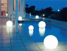 These Moonlight globe lights can be placed in a pool, hung from a tree, or incorporated into hardscape features like a patio. Love that soft glow.