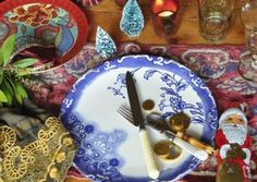 Christmas poetic wanderlust- add festive touches to your holiday tabletop- colorful textiles, tiny trees, gold coins layers of candlelight...cheers + love! xx tracy porter