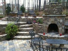 Charlotte Outdoor Fireplace Photos - stonework, stacked rock, wood burning fireplace