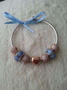 PANDORA Bracelet with Lovely Blue and Gold Charms.