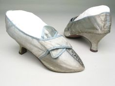 Pale blue satin bound with blue silk ribbon over white linen.1785-1800    Accession Number: 1947.923  Image Copyright: © Manchester City Galleries  Pointed toes. Metal thread and spangle embroidery in leaf shape down centre front to toe. Inscription inside.