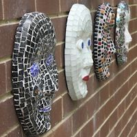 Wall of mosaic faces at the Leadlight By Ettore studio