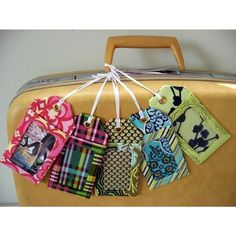 A fabulous way to use scraps of fabric that I don't have the heart to throw out. Plus, I'll be able to recognize my black suitcase in the conveyor belt sea of generic black suitcases.