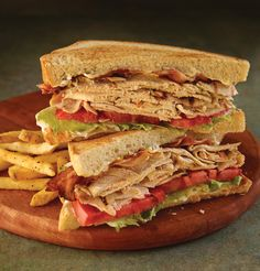 CLASSIC CLUB SANDWICH Toasted sourdough bread layered with rich mayonnaise, iceberg lettuce, vine-ripened tomato, smoked bacon and thinly sliced grilled chicken.