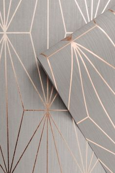 This Kayla Geometric Wallpaper features a geometric pattern of elongated triangles with a metallic rose gold finish on a grey background with a lined texture Grey And Gold Wallpaper, Geometric Wallpaper Grey, Metallic Wallpaper, Grey Wallpaper Feature Wall, Contemporary Wallpaper, Wallpaper Decor, Bedroom Wallpaper Wall, Wallpaper Ideas, Wallpaper For Hallways