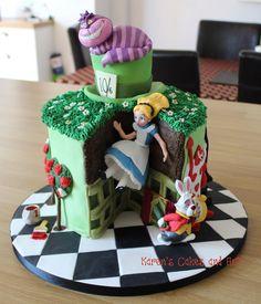 Alice in Wonderland cake. Cheshire Cat, Mad hatter's hat, playing cards, white rabbit, checkerboard effect. https://www.facebook.com/karenscakesandart