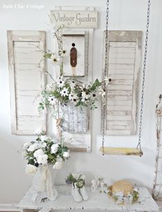 Junk Chic Cottage: Swinging! Love the old swing check out pictures with angels and other decor on it. Wonder if I could use my old wicker porch swing somehow like this. . . .