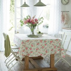 http://thedecorologist.com/wp-content/uploads/2010/03/dining-room-with-cath-kidston-fabric-via-housetohome.jpg