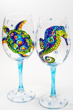 These beach wedding wine glasses are great as bridesmaid gifts or as summer wedding favors.  *This is a listing for 2 wine glasses Ill gladly personalize the base of the glasses with your names and wedding date  * Measurements: Height 22 cm / 8,7 inch About 445 ml / 15 oz  Need to accommodate non-wine drinkers? I stock a variety of glassware and can paint your design on juice glasses, tumblers, beer glasses, etc. CUSTOM ORDERING: This pattern can be reproduced on any form of clear glass…