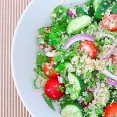 Quinoa Tabouli Salad :: Rinse quinoa very well. Place in a saucepan with 1 C water and a dash of salt and bring to the boil. Reduce heat to a simmer and cover. Let if cook for around 10 minutes, or until it is tender. Remove from saucepan, rinse and drain, then fluff with a fork. In a large bowl combine the cucumber, tomato, onion, shallots, parsley, mint and cooled quinoa. // Full recipe @ http://naturalfertilitybreakthrough.com/food-nutrition/meal-plans-recipes/quinoa-tabouli-salad/