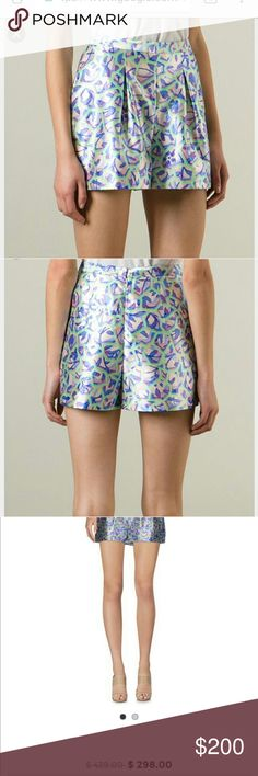 Peter Pilotto designer shorts size 6 These are gorgeous!these are the real designer label, not the 'for Target' line. There is a minor fabric flaw near the seam on the back side (see zoomed in pictures) it is barely noticable. These are a US 6 or UK 10. Waist is 26 inches, flare out at hips to 36. Length from waist is about 13 inches. Amazeballs! Peter Pilotto Shorts