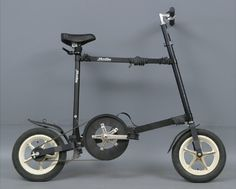 """The MicroBike folding bike was designed by Otto Linander and Sven Hellestam in 1987 and was made in Sweden, it is no longer in production.  The above example is a 1993 model.  It had 12"""" plastic wheels, an aluminum frame, weighed 8.5kgs, and featured a Kevlar belt drive."""