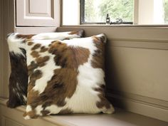 Scatter cowhide accent pillows by Indigo |  Andrea's Innovative Interiors - Andrea's Blog - It's Movember!!